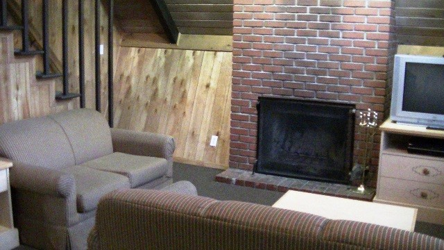 Big Bear Cabin Loft · A Cabin Living Area And Fireplace.